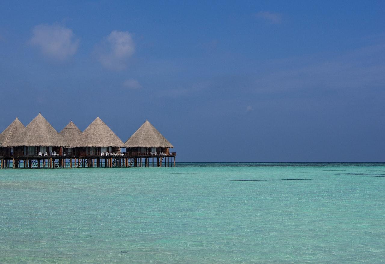 beach-beach-hut-blue-sky-bungalow